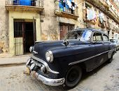 A Classic Old Car Is Black Color