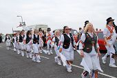 HASTINGS, ENGLAND - MAY 7: Morris dancers perform during a parade on the West Hill at the annual Jac