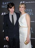 LOS ANGELES - MAR 12:  Freddie Highmore & Vera Farmiga arrives to the A&E Network Premiere of
