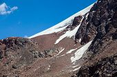 Snow slope of red mountain. Tien Shan
