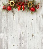 Christmas decoration on old grunge wooden board
