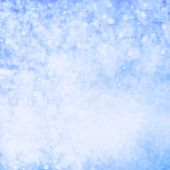 Glittering Lights Festive Background With Texture. White And Blue Abstract Christmas Twinkled Bright
