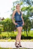 picture of leggy  - Pretty leggy blonde posing in jeans suit - JPG