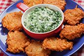 Thick and creamy spinach soup with potato pancakes