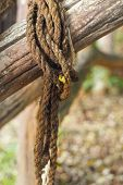 Old Rope Tied To A Piece Of Old Wood.