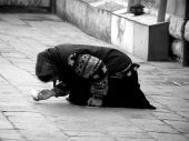 stock photo of peddlers  - Beggar woman on the street of Venice (Italy - Europe); black and white image;