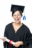 stock photo of school-leaver  - Graduating student in spectacles and academic gown with the diploma - JPG