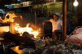 Fiery cooking at the night market in Hua Hin