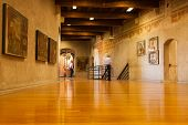 VERONA, ITALY - 17th SEP 2013: A visitor admires some of the artwork in the Castelvecchio Museum.