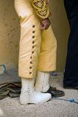 detail of the uniform of the picador carries a steel boot so the bull not injured his leg