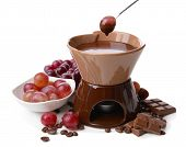 Chocolate fondue with fruits, isolated on white