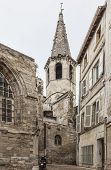 stock photo of avignon  - Old stone church and a narrow street located in Avignon in South of France - JPG