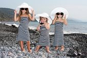 Adorable Glamour Happy Smiling Little Girl In Beach Hats On Beach Vacation