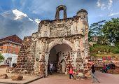 Tourist go to visit Porta de Santiago