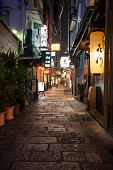 OSAKA, JAPAN - MAY 28, 2008: Narrow street in the old part of the central area of Osaka. Such street is integral architectural landmark of Osaka, and attract many tourists from all over the world.