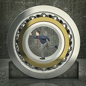 image of ball bearing  - man run inside of huge ball bearing - JPG