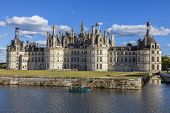 Family On A Boat In Front Of Chambord Castle
