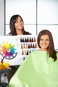 Hair Salon. Woman Choses Color Of Dye.