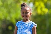 Outdoor Close Up Portrait Of A Cute Young Black Girl - African People