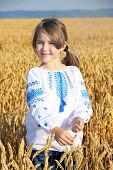 Small Rural Girl On Wheat Field
