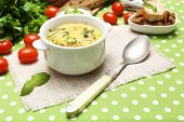 image of saucepan  - Tasty soup in saucepan on tablecloth - JPG