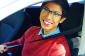 stock photo of seatbelt  - Young asian man fastening seat belt - JPG