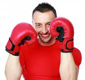 Portrait of a cheerful sportsman in boxing gloves over white background
