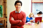 stock photo of students classroom  - Happy young asian student in classroom - JPG