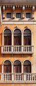 Arched windows of a house texture. Venetian gothic architectural style.