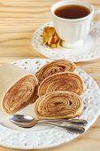 Bolo De Rolo (swiss Roll, Rollcake)  Brazilian Dessert With Cup Of Tea