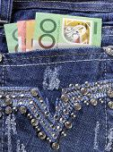 Australian Money In Back Pocket Of Feminine Ladies Rhinestone Decorated Jeans Close Up.