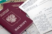 Russian passport, plane ticket and map