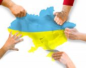 tearing map of the country Ukraine on piece referendum and elections