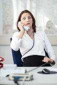 Businesswoman Is Shocked At The Phone