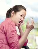 Woman Expressing Displeasure With Cellphone