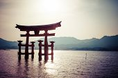 Miyajima, Famous Big Shinto Torii Standing In The Ocean In Hiroshima, Japan