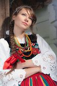 Young woman in Mazovia national costume, a Polish folk costume, looking away
