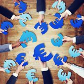 Group of Hands Holding European Currency Symbol