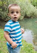 Child Beside A Lake