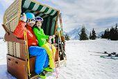 Ski, skier, sun - family enjoying winter vacations