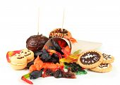 Different sweets for Halloween party, isolated on white