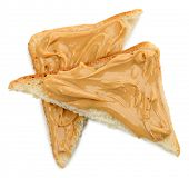 Slices of bread with creamy peanut butter, isolated on white