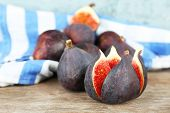 Ripe sweet figs on wooden background
