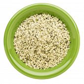 hemp seed hearts on an isolated green bowl