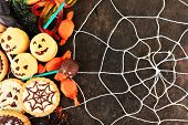 picture of spiderwebs  - Different sweets for Halloween party on dark background with spiderweb - JPG