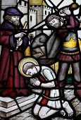 image of beheaded  - Victorian stained glass window depicting Saint George about to be beheaded with a sword - JPG