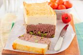 stock photo of meatloaf  - Beef Meatloaf with Green Peas Topped with Cheesy Mashed Potato copy space for your text - JPG
