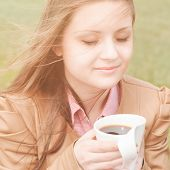 Beautiful Woman Early In Morning Withcup Of Coffee Outdoors