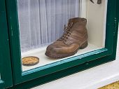 an old shoe in a window