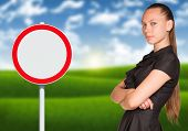 Businesswoman and empty road sign
